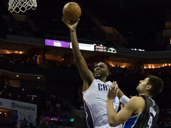 Dec 11, 2013; Charlotte, NC, USA; Charlotte Bobcats center Al Jefferson (25) goes up for a shot during the second half against the Orlando Magic at Time Warner Cable Arena. The Magic defeated the Bobcats 92-83. Mandato