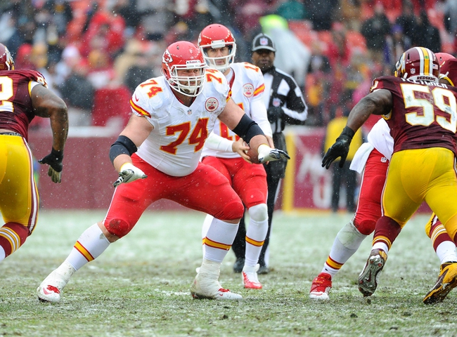 Dec 8, 2013; Landover, MD, USA; Kansas City Chiefs offensive lineman Geoff Schwartz (74) prepares to block against the Washington Redskins during the second quarter at FedEx Field. Mandatory Credit: Brad Mills-USA TODAY Sports
