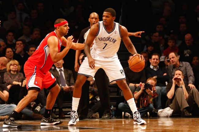Dec 12, 2013; Brooklyn, NY, USA;  Brooklyn Nets shooting guard Joe Johnson (7) readies a drive against Los Angeles Clippers small forward Jared Dudley (9) during the first quarter at Barclays Center. Mandatory Credit: Anthony Gruppuso-USA TODAY Sports