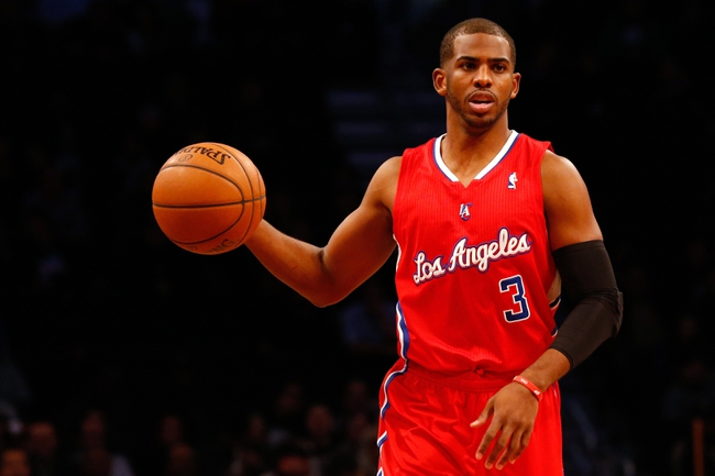Dec 12, 2013; Brooklyn, NY, USA;   Los Angeles Clippers point guard Chris Paul (3) advances the ball during the first quarter against the Brooklyn Nets at Barclays Center. Mandatory Credit: Anthony Gruppuso-USA TODAY Sports