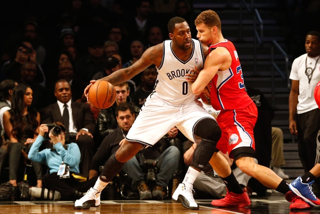 Dec 12, 2013; Brooklyn, NY, USA;   Brooklyn Nets center Andray Blatche (0) drives through Los Angeles Clippers power forward Blake Griffin (32) during the first quarter at Barclays Center. Mandatory Credit: Anthony Gruppuso-USA TODAY Sports