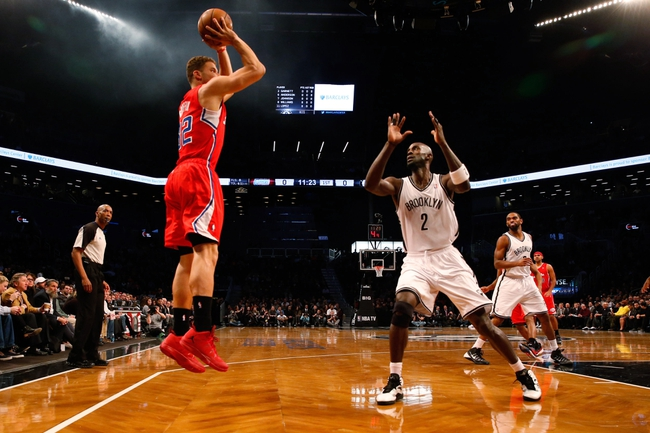 Dec 12, 2013; Brooklyn, NY, USA;  Los Angeles Clippers power forward Blake Griffin (32) shoots for three over Brooklyn Nets power forward Kevin Garnett (2) during the first quarter at Barclays Center. Mandatory Credit: Anthony Gruppuso-USA TODAY Sports