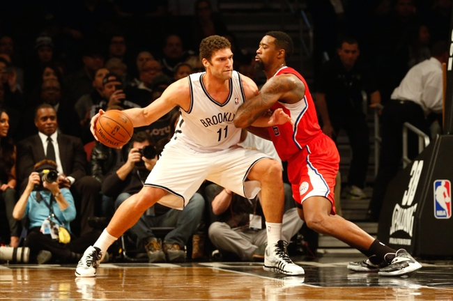 Dec 12, 2013; Brooklyn, NY, USA;  Brooklyn Nets center Brook Lopez (11) drives against Los Angeles Clippers center DeAndre Jordan (6) during the first quarter at Barclays Center. Mandatory Credit: Anthony Gruppuso-USA TODAY Sports