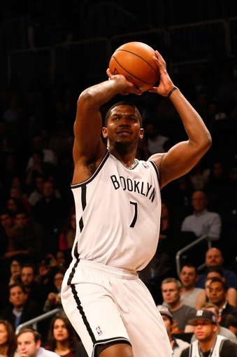 Dec 12, 2013; Brooklyn, NY, USA; Brooklyn Nets shooting guard Joe Johnson (7) shoots for three during the third quarter against the Los Angeles Clippers at Barclays Center. Brooklyn Nets won 102-93.  Mandatory Credit: Anthony Gruppuso-USA TODAY Sports
