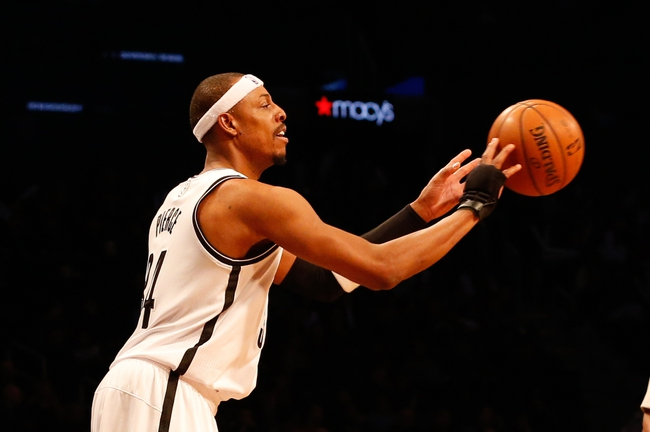 Dec 12, 2013; Brooklyn, NY, USA;  Brooklyn Nets small forward Paul Pierce (34) passes during the third quarter against the Los Angeles Clippers at Barclays Center. Brooklyn Nets won 102-93.  Mandatory Credit: Anthony Gruppuso-USA TODAY Sports