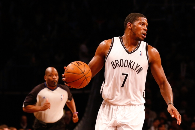 Dec 12, 2013; Brooklyn, NY, USA;  Brooklyn Nets shooting guard Joe Johnson (7) advances the ball during the third quarter against the Los Angeles Clippers at Barclays Center. Brooklyn Nets won 102-93.  Mandatory Credit: Anthony Gruppuso-USA TODAY Sports