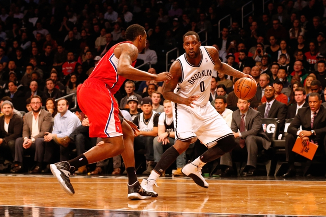 Dec 12, 2013; Brooklyn, NY, USA;  Brooklyn Nets center Andray Blatche (0) drives around Los Angeles Clippers center DeAndre Jordan (6) during the third quarter at Barclays Center. Brooklyn Nets won 102-93.  Mandatory Credit: Anthony Gruppuso-USA TODAY Sports