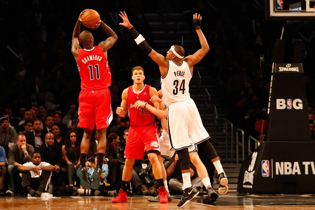 Dec 12, 2013; Brooklyn, NY, USA;  Los Angeles Clippers shooting guard Jamal Crawford (11) shoots over Brooklyn Nets small forward Paul Pierce (34) during the third quarter at Barclays Center. Brooklyn Nets won 102-93.  Mandatory Credit: Anthony Gruppuso-USA TODAY Sports