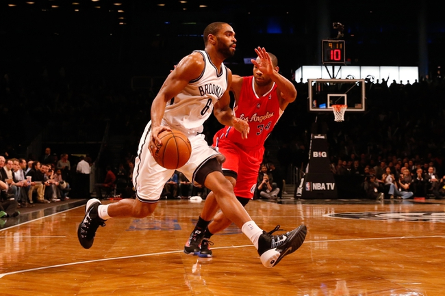 Dec 12, 2013; Brooklyn, NY, USA;  Brooklyn Nets shooting guard Alan Anderson (6) drives past Los Angeles Clippers shooting guard Willie Green (34) during the third quarter at Barclays Center. Brooklyn Nets won 102-93.  Mandatory Credit: Anthony Gruppuso-USA TODAY Sports