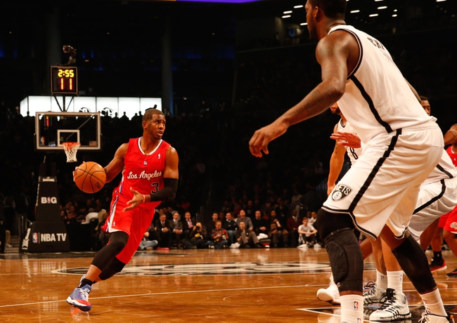 Dec 12, 2013; Brooklyn, NY, USA; Los Angeles Clippers point guard Chris Paul (3) drives the ball during the first quarter against the Brooklyn Nets at Barclays Center. Brooklyn Nets won 102-93.  Mandatory Credit: Anthony Gruppuso-USA TODAY Sports