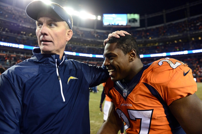 Dec 12, 2013; Denver, CO, USA; Denver Broncos running back Knowshon Moreno (27) and San Diego Chargers head coach Mike McCoy greet each other following the game at Sports Authority Field at Mile High. The San Diego Chargers defeated the Denver Broncos 27-20. Mandatory Credit: Ron Chenoy-USA TODAY Sports