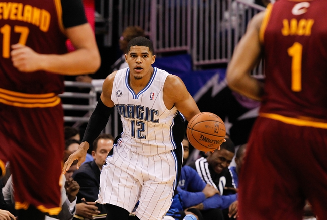 Dec 13, 2013; Orlando, FL, USA; Orlando Magic small forward Tobias Harris (12) drives to the basket against the Cleveland Cavaliers during the second half at Amway Center. Cleveland Cavaliers defeated the Orlando Magic 109-100. Mandatory Credit: Kim Klement-USA TODAY Sports