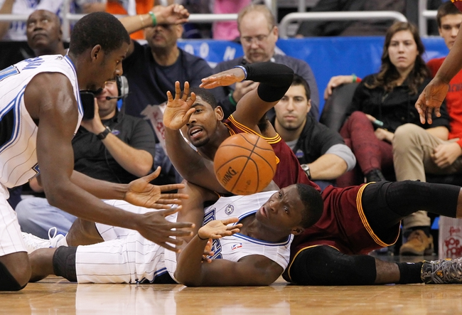 Dec 13, 2013; Orlando, FL, USA; Cleveland Cavaliers point guard Kyrie Irving (2) and Orlando Magic shooting guard Victor Oladipo (5) go after the loose ball during the second half at Amway Center. Cleveland Cavaliers defeated the Orlando Magic 109-100. Mandatory Credit: Kim Klement-USA TODAY Sports