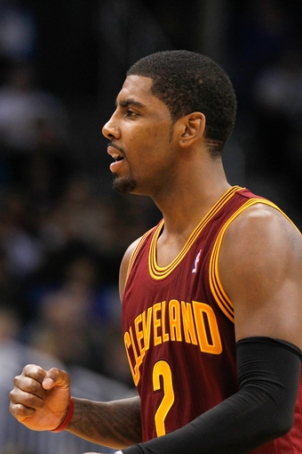 Dec 13, 2013; Orlando, FL, USA; Cleveland Cavaliers point guard Kyrie Irving (2) pumps his fist during the second half against the Orlando Magic at Amway Center. Cleveland Cavaliers defeated the Orlando Magic 109-100. Mandatory Credit: Kim Klement-USA TODAY Sports