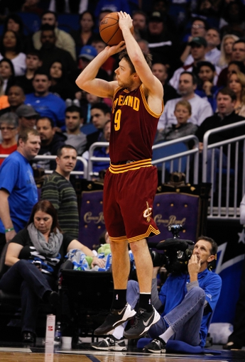 Dec 13, 2013; Orlando, FL, USA; Cleveland Cavaliers shooting guard Matthew Dellavedova (9) shoots a three pointer against the Orlando Magic during the second half at Amway Center. Cleveland Cavaliers defeated the Orlando Magic 109-100. Mandatory Credit: Kim Klement-USA TODAY Sports