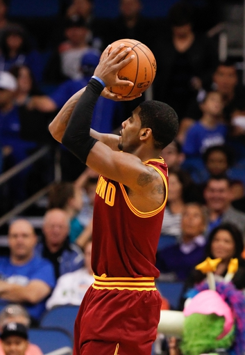 Dec 13, 2013; Orlando, FL, USA; Cleveland Cavaliers point guard Kyrie Irving (2) shoots against the Orlando Magic during the second half at Amway Center. Cleveland Cavaliers defeated the Orlando Magic 109-100. Mandatory Credit: Kim Klement-USA TODAY Sports