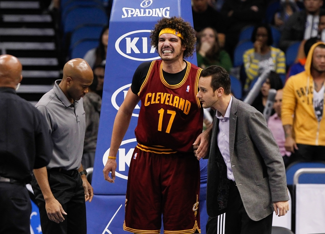 Dec 13, 2013; Orlando, FL, USA; Cleveland Cavaliers center Anderson Varejao (17) reacts after he stand up after he hurt his knee as Orlando Magic power forward Andrew Nicholson (44) (not pictured) got called for a fragrant 2 foul during the second half at Amway Center. Cleveland Cavaliers defeated the Orlando Magic 109-100. Mandatory Credit: Kim Klement-USA TODAY Sports