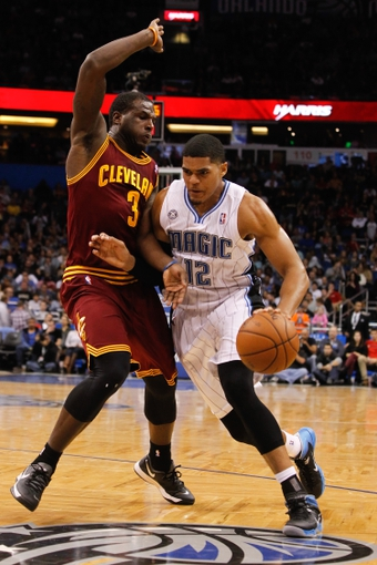 Dec 13, 2013; Orlando, FL, USA; Orlando Magic small forward Tobias Harris (12) drives to the basket as Cleveland Cavaliers shooting guard Dion Waiters (3) defends during the second half at Amway Center. Cleveland Cavaliers defeated the Orlando Magic 109-100. Mandatory Credit: Kim Klement-USA TODAY Sports
