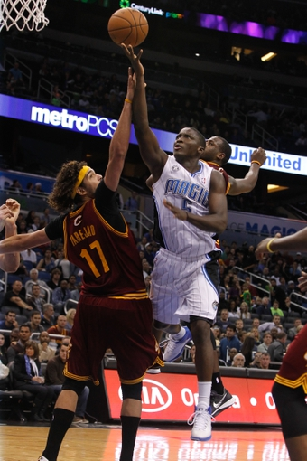 Dec 13, 2013; Orlando, FL, USA; Orlando Magic shooting guard Victor Oladipo (5) shoots over Cleveland Cavaliers center Anderson Varejao (17) during the second half at Amway Center. Cleveland Cavaliers defeated the Orlando Magic 109-100. Mandatory Credit: Kim Klement-USA TODAY Sports