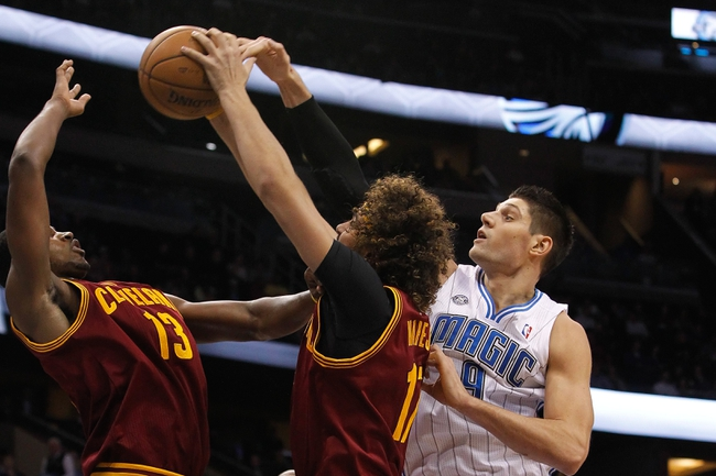 Dec 13, 2013; Orlando, FL, USA; Cleveland Cavaliers power forward Tristan Thompson (13), center Anderson Varejao (17) and Orlando Magic center Nikola Vucevic (9) go after the rebound during the second half at Amway Center. Cleveland Cavaliers defeated the Orlando Magic 109-100. Mandatory Credit: Kim Klement-USA TODAY Sports