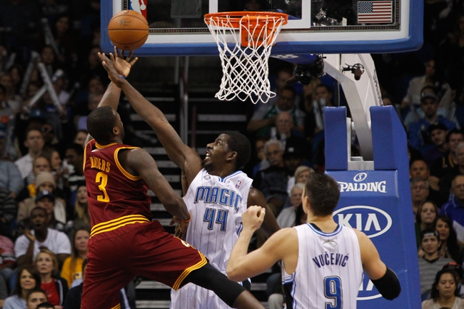 Dec 13, 2013; Orlando, FL, USA; Cleveland Cavaliers shooting guard Dion Waiters (3) shoots over Orlando Magic power forward Andrew Nicholson (44) during the second half at Amway Center. Cleveland Cavaliers defeated the Orlando Magic 109-100. Mandatory Credit: Kim Klement-USA TODAY Sports