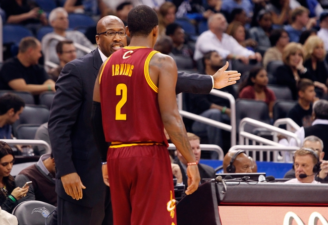 Dec 13, 2013; Orlando, FL, USA; Cleveland Cavaliers head coach Mike Brown talks with point guard Kyrie Irving (2) against the Orlando Magic during the second half at Amway Center. Cleveland Cavaliers defeated the Orlando Magic 109-100. Mandatory Credit: Kim Klement-USA TODAY Sports