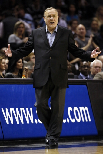 Dec 13, 2013; San Antonio, TX, USA; Minnesota Timberwolves head coach Rick Adelman reacts during the second half against the San Antonio Spurs at AT&T Center. The Spurs won 117-110. Mandatory Credit: Soobum Im-USA TODAY Sports