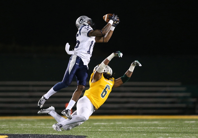 Dec 14, 2013; Hammond, LA, USA; New Hampshire Wildcats wide receiver R.J. Harris (15) catches a pass over Southeastern Louisiana Lions linebacker Isaiah Corbett (6) in the first half at Strawberry Stadium. Mandatory Credit: Crystal LoGiudice-USA TODAY Sports