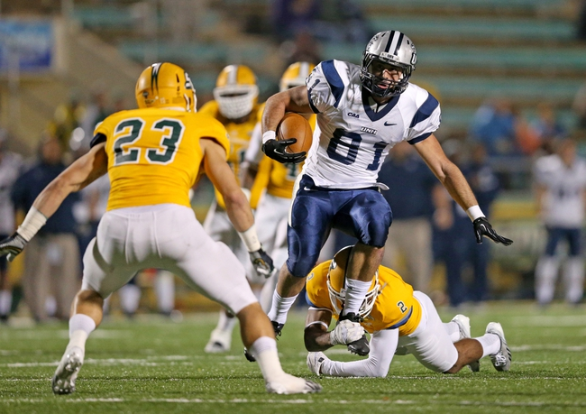 Dec 14, 2013; Hammond, LA, USA; New Hampshire Wildcats wide receiver Justin Mello (81) carries the ball in front of Southeastern Louisiana Lions defensive back Kevin Harmon (2) in the first half at Strawberry Stadium. Mandatory Credit: Crystal LoGiudice-USA TODAY Sports