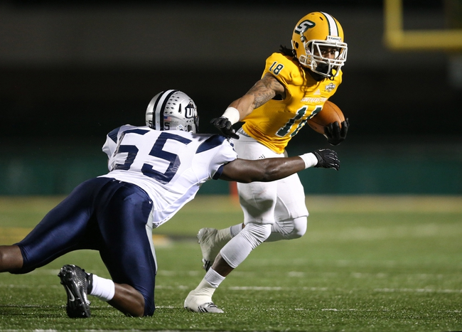 Dec 14, 2013; Hammond, LA, USA; Southeastern Louisiana Lions wide receiver Marquis Hayes (18) fights off New Hampshire Wildcats defensive end Jay Colbert (55) in the first half at Strawberry Stadium. Mandatory Credit: Crystal LoGiudice-USA TODAY Sports