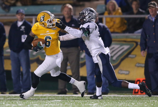 Dec 14, 2013; Hammond, LA, USA; New Hampshire Wildcats safety Manny Asam (4) grabs the face mask of Southeastern Louisiana Lions wide receiver Tony McCrea (6) which resulted in a face mask penalty in the first half at Strawberry Stadium. Mandatory Credit: Crystal LoGiudice-USA TODAY Sports