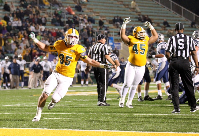 Dec 14, 2013; Hammond, LA, USA; Southeastern Louisiana Lions linebacker Justin Church (95) and teammate A.J. Bowen (45) celebrate a blocked field goal attempt by the New Hampshire Wildcats in the first half at Strawberry Stadium. Mandatory Credit: Crystal LoGiudice-USA TODAY Sports