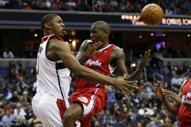 Dec 14, 2013; Washington, DC, USA; Washington Wizards center Kevin Seraphin (13) knocks the ball from Los Angeles Clippers shooting guard Jamal Crawford (11) in the fourth quarter at Verizon Center. The Clippers won 113-97. Mandatory Credit: Geoff Burke-USA TODAY Sports