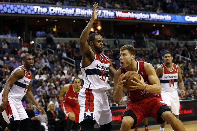 Dec 14, 2013; Washington, DC, USA; Los Angeles Clippers power forward Blake Griffin (32) dribbles the ball as Washington Wizards power forward Trevor Booker (35) defends in the third quarter at Verizon Center. The Clippers won 113-97. Mandatory Credit: Geoff Burke-USA TODAY Sports