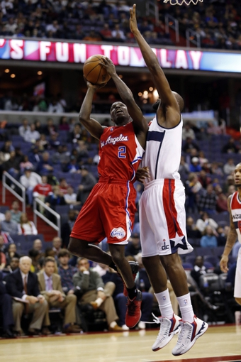 Dec 14, 2013; Washington, DC, USA; Los Angeles Clippers point guard Darren Collison (2) shoots the ball as Washington Wizards small forward Chris Singleton (31) defends in the fourth quarter at Verizon Center. Mandatory Credit: Geoff Burke-USA TODAY Sports