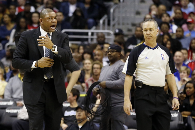 Dec 14, 2013; Washington, DC, USA; Los Angeles Clippers head coach Doc Rivers argues a call with referee Jason Phillips (23) against the Washington Wizards in the third quarter at Verizon Center. Mandatory Credit: Geoff Burke-USA TODAY Sports