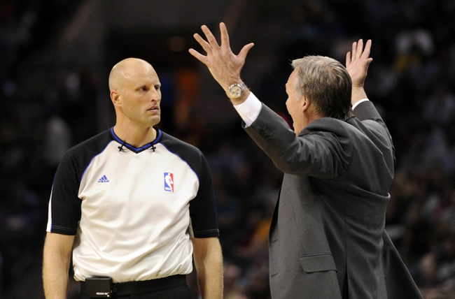 Dec 14, 2013; Charlotte, NC, USA; Los Angeles Lakers head coach Mike D'Antoni complains to the referee during the second half of the game against the Charlotte Bobcats at Time Warner Cable Arena. Lakers win 88-85. Mandatory Credit: Sam Sharpe-USA TODAY Sports