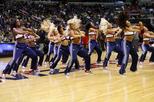 Dec 14, 2013; Washington, DC, USA; Washington Wizards girls dance during a stoppage in play against the Los Angeles Clippers at Verizon Center. Mandatory Credit: Geoff Burke-USA TODAY Sports