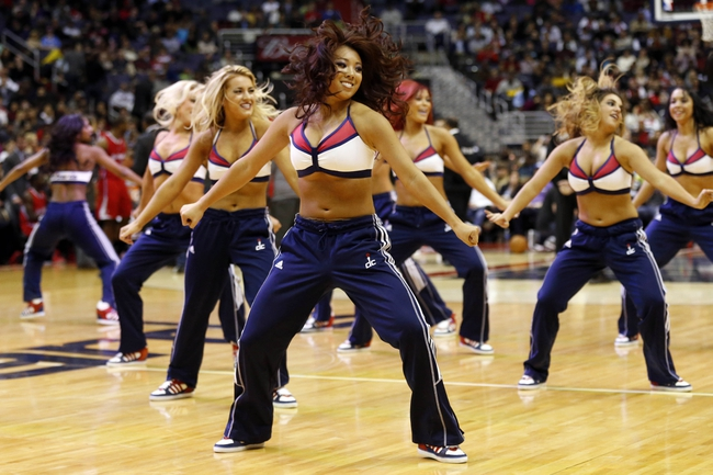 Dec 14, 2013; Washington, DC, USA; Washington Wizards girls dance during a stoppage in play against the Los Angeles Clippers at Verizon Center. The Clippers won 113-97. Mandatory Credit: Geoff Burke-USA TODAY Sports