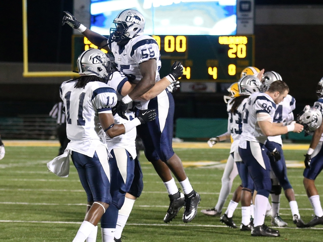 Dec 14, 2013; Hammond, LA, USA; New Hampshire Wildcats defensive end Jay Colbert (55) is lifted up by a teammate after defeating the Southeastern Louisiana Lions 20-17 at Strawberry Stadium. Mandatory Credit: Crystal LoGiudice-USA TODAY Sports