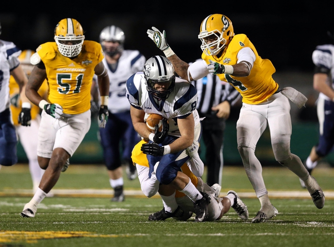 Dec 14, 2013; Hammond, LA, USA; New Hampshire Wildcats wide receiver Justin Mello (81) is tackled front behind beside Southeastern Louisiana Lions defensive back Theo Alexander (4) in the second half at Strawberry Stadium. New Hampshire defeated Southeastern Louisiana 20-17. Mandatory Credit: Crystal LoGiudice-USA TODAY Sports
