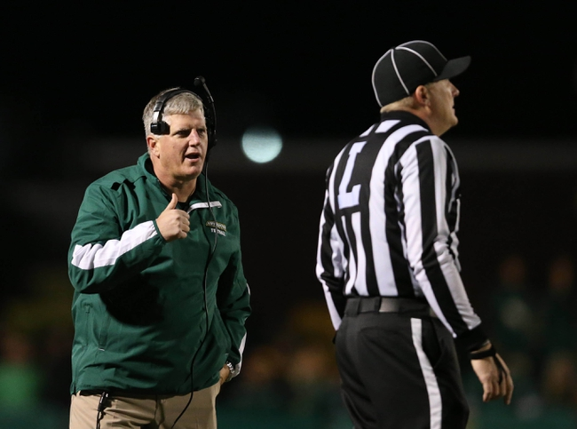 Dec 14, 2013; Hammond, LA, USA; Southeastern Louisiana Lions head coach Ron Roberts talks with a referee in the second half against the New Hampshire Wildcats at Strawberry Stadium. New Hampshire defeated Southeastern Louisiana 20-17. Mandatory Credit: Crystal LoGiudice-USA TODAY Sports