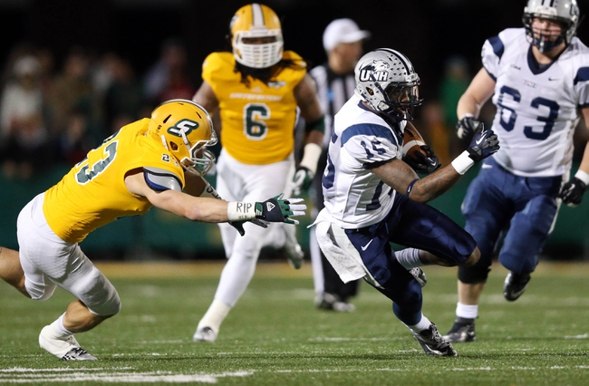 Dec 14, 2013; Hammond, LA, USA; New Hampshire Wildcats wide receiver R.J. Harris (15) carries the ball in front of Southeastern Louisiana Lions defensive back Tyler Stoddard (23) in the second half at Strawberry Stadium. New Hampshire defeated Southeastern Louisiana 20-17. Mandatory Credit: Crystal LoGiudice-USA TODAY Sports