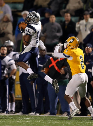 Dec 14, 2013; Hammond, LA, USA; New Hampshire Wildcats wide receiver R.J. Harris (15) catches a pass in front of Southeastern Louisiana Lions defensive back Kevin Harmon (2) in the second half at Strawberry Stadium. New Hampshire defeated Southeastern Louisiana 20-17. Mandatory Credit: Crystal LoGiudice-USA TODAY Sports