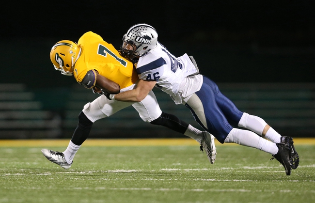 Dec 14, 2013; Hammond, LA, USA; New Hampshire Wildcats safety Hayden Knudson (46) tackles Southeastern Louisiana Lions wide receiver Marquis Fruge' (7) in the second half against the New Hampshire Wildcats at Strawberry Stadium. New Hampshire defeated Southeastern Louisiana 20-17. Mandatory Credit: Crystal LoGiudice-USA TODAY Sports