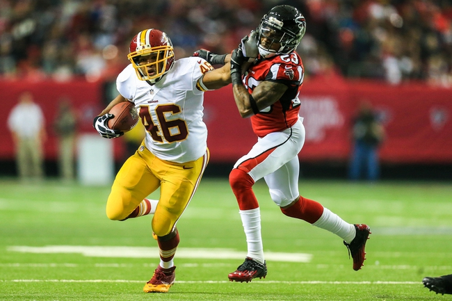 Dec 15, 2013; Atlanta, GA, USA; Washington Redskins running back Alfred Morris (46) runs the ball against Atlanta Falcons cornerback Robert Alford (23) in the first half at the Georgia Dome. Mandatory Credit: Daniel Shirey-USA TODAY Sports