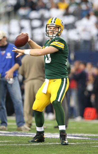Dec 15, 2013; Arlington, TX, USA; Green Bay Packers quarterback Matt Flynn (10) throws prior to the game against the Dallas Cowboys at AT&T Stadium. Mandatory Credit: Matthew Emmons-USA TODAY Sports
