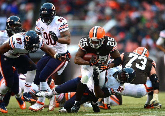 Dec 15, 2013; Cleveland, OH, USA; Cleveland Browns running back Chris Ogbonnaya (25) runs the ball during the fourth quarter against the Chicago Bears at FirstEnergy Stadium. Mandatory Credit: Andrew Weber-USA TODAY Sports