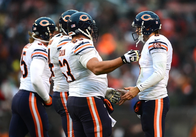 Dec 15, 2013; Cleveland, OH, USA; Chicago Bears quarterback Jay Cutler (6) celebrates with center Roberto Garza (63) after a touchdown during the fourth quarter against the Cleveland Browns  at FirstEnergy Stadium. Mandatory Credit: Andrew Weber-USA TODAY Sports
