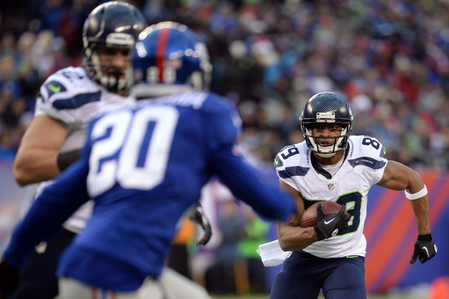 Dec 15, 2013; East Rutherford, NJ, USA; Seattle Seahawks wide receiver Doug Baldwin (89) runs the ball against the New York Giants during the second half at MetLife Stadium. Mandatory Credit: Joe Camporeale-USA TODAY Sports